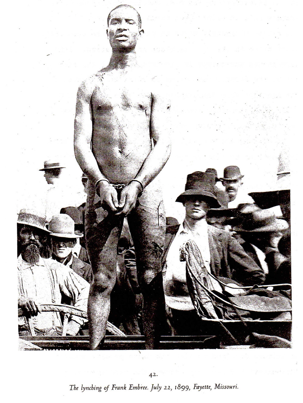 Frank Embree before lynching, Fayette, Missouri, 1899. He was handcuffed, stripped naked and whipped, later lynched and castrated. Before and after images of him were sold as postcards. Source: Without Sanctuary: Lynching Photography in America
